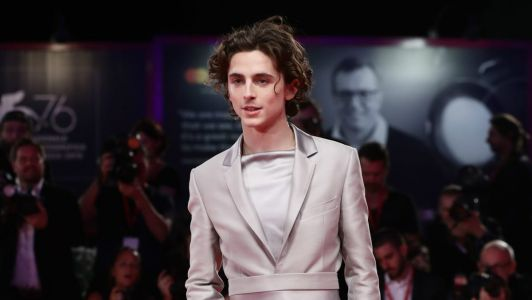 Great Outfits in Fashion History: Timotheé Chalamet's Satin Suit and Cowboy Boots