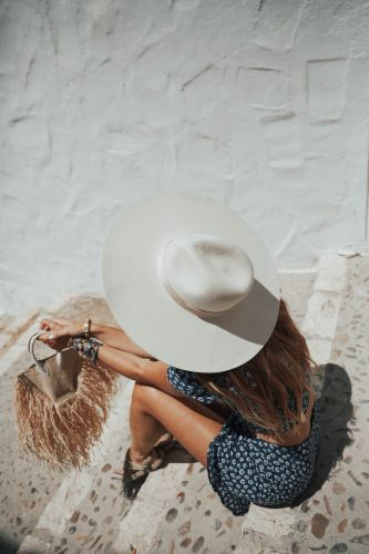 THE GIRL OF THE BIG HAT