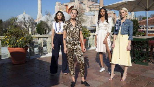 Kristen Stewart Wears a 'Leopard Print Lounging Suit' and a Lot of 'Barbie Doll' Pink in 'Charlie's Angels'