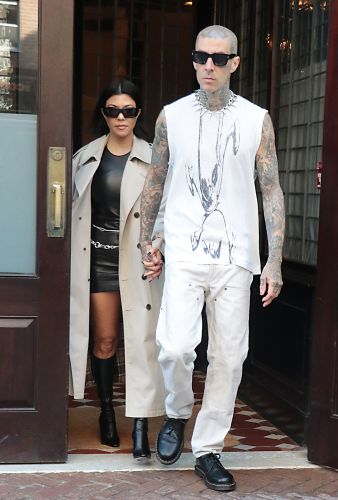 Kourtney Kardashian and Travis Barker Hold Hands While Stepping Out in Coordinating Outfits in NYC