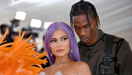 Travis Scott Missed Kylie Jenner's Epic All-Pink Kylie Skin Launch Party and Seemingly Went to Get a Tattoo Instead