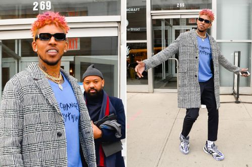 Nick Young is not afraid to be Swaggy in pink at Fashion Week