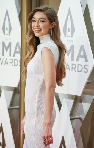 Gigi Hadid Finally Gives Fans a Peek at Her Growing Baby Bump: 'There's My Belly'