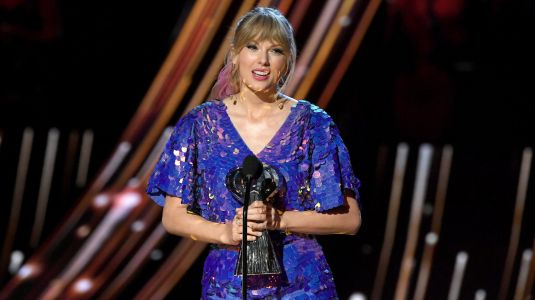Taylor Swift Thanks Fans in Emotional iHeartRadio Speech - and Hints She's Dropping New Music!