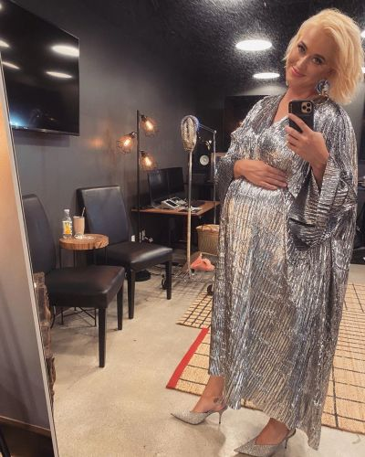 So Chic! Katy Perry Cradles Growing Baby Bump in Metallic Silver Dress for Space Launch Live Event