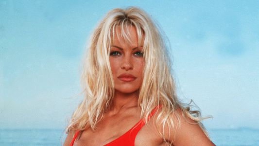 Pamela Anderson Still Rocks Her 'Baywatch' Swimsuit and Uses it to Up Her Dating Game
