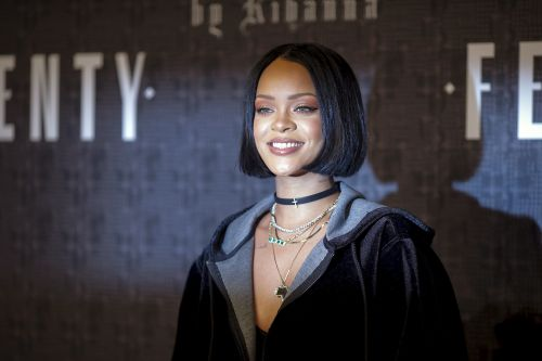 Rihanna-designed sneakers propel Puma's sales