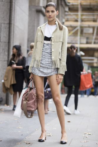 Style your fringed suede jacket with a simple tee and smart
