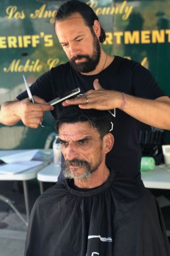 Barber Sascha Breuer Offers Free Haircuts to Those in Need
