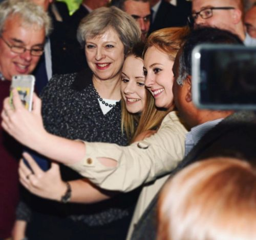 Theresa May says tuition fees are too high