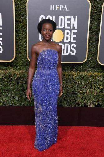 Lupita Nyong'o in Calvin Klein Appointment dress and Bvlgari