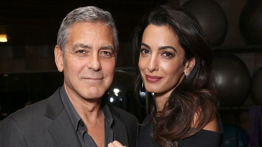 George and Amal Clooney Handed out Headphones to Passengers Sharing a Flight With Their Twins