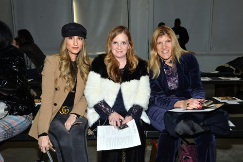 Designer flaunts high-powered execs at first fashion show