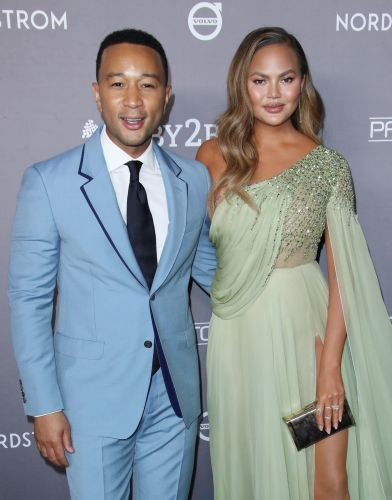 Chrissy Teigen Hilariously Reacts to John Legend's ~Sexiest Man Alive~ Elf Strip Tease