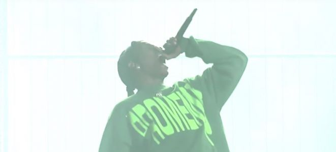 A$AP Rocky performs in a cage on his first trip to Sweden after his arrest