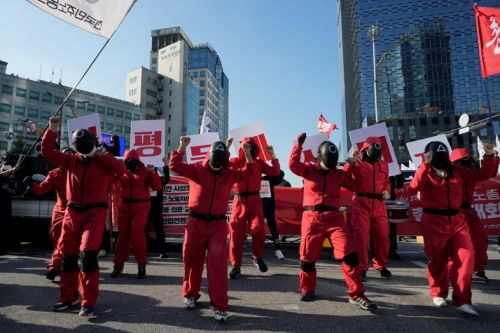 South Koreans rally for employment rights dressed as Squid Game characters