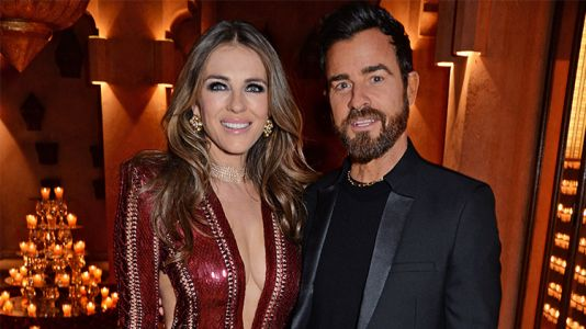Elizabeth Hurley And Justin Theroux Cuddle Up At Racing Event
